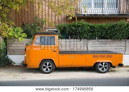 An Old Oldtimer Orange Pick-up Park On The Street
