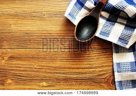 Wooden spoon on wood texture of dining table .Ttop view .Background in kitchen and food concept