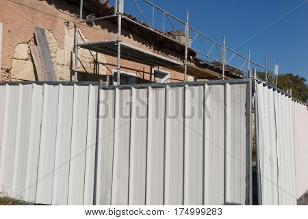 Construction Site Barriers Protect The Work On The House From Viewing
