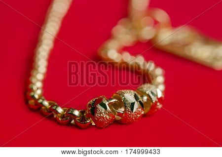 Gold Necklace 96.5 Percent Gold Grade With Italy Design On Red Flannel Cloth Background