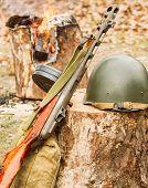 Soviet soldier's helmet near the submachine gun Shpagin poster
