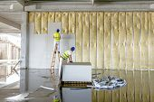 Workers are assembly gypsum wall. Plasterboard is under construction using wooden ladder. poster