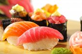 Japanese Cuisine - Sushi Set: Salmon, Conger and Tuna Sushi with Salad Leaf poster