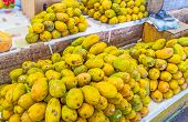 The heaps of yellow papaya on the counter of the stall in Fose Market Colombo Sri Lanka. poster
