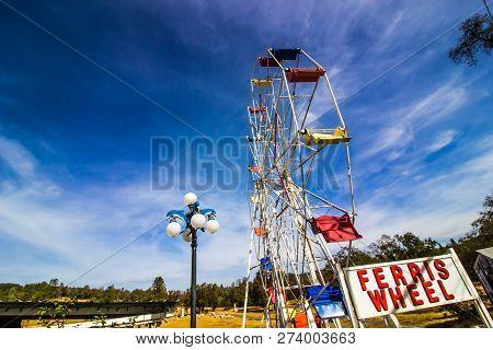 Old Ferris Wheels In Disrepair In Field