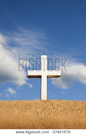 White Cross On Adobe Wall