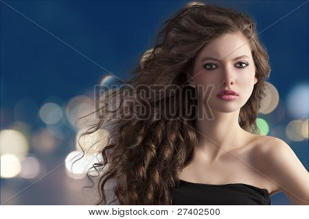 Brunette On City Light Bokeh