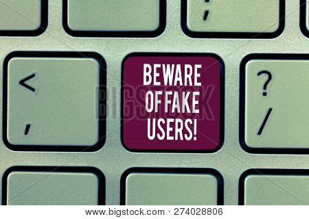 Writing note showing Beware Of Fake Users. Business photo showcasing Be aware of safety and danger in online communications Keyboard Intention to create computer message keypad idea. poster