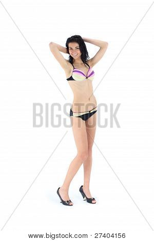 Full- lenth photo of sexy beautiful blond woman in summer swimsuit bikini isolated against white bac