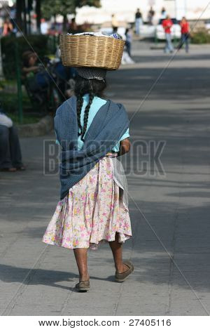 A Guatemalan woman on her way to the local community clothes wash