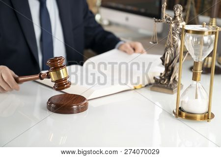 Lawyer Concept Background. Lawyer Working At The Office. Gavel, Themis Statue And Legal Book On The