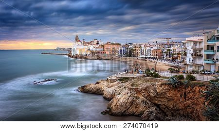 Sunset Over Sitges, Catalunya, Spain. Sitges Is A Famous Town Near Barcelona, Famous For It's Nightl