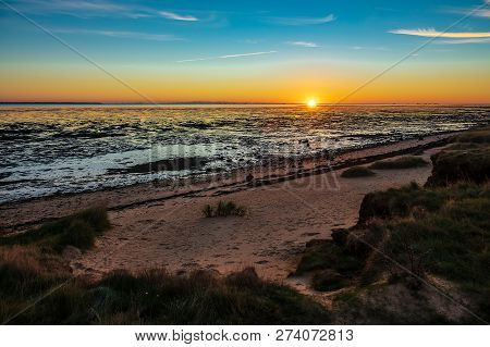 Sunrise On The North Sea Coast On The Island Amrum, Germany.