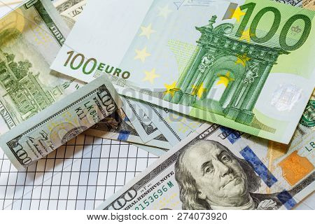 One Hundred Dollar Bills And Bills Of One Hundred Euros. Worlds Major Currencies. Money.
