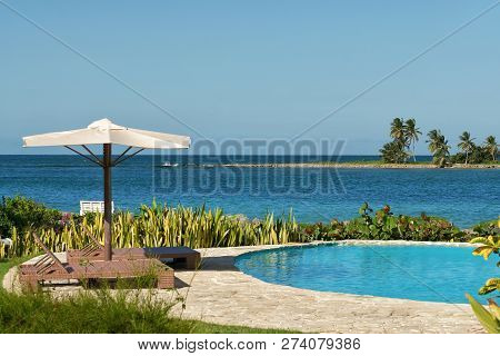 Travel Vacation Tropical Destination. Swimming Pool Beach Landscape. Travel Vacations Destination. T