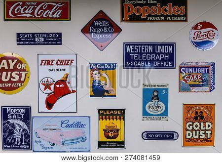 Cuba, Missouri - April 5, 2018 - Collection Of Vintage Metal Signs And Logos Of Former And Actual Co
