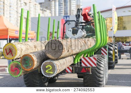 Tip Truck Transportation Of Sawn Timber. The Truck Transports Logs, On The Road. Cut Logs Are Loaded