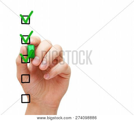 Hand Putting Three Check Marks With Green Marker On Blank Customer Survey Checklist On Transparent G