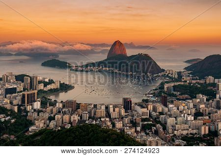 View Of Botafogo And The Sugarloaf Mountain By Sunset In Rio De Janeiro, Brazil