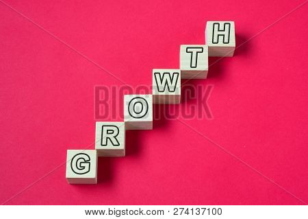 Wooden Blocks Arranged In Stair Shape With Word Growth For Career, Financial, Economy Or Investment
