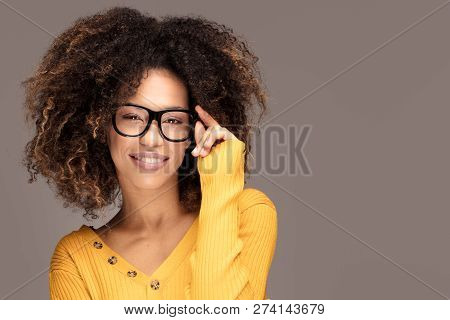 Young Girl With An Afro Wearing Eyeglasses.