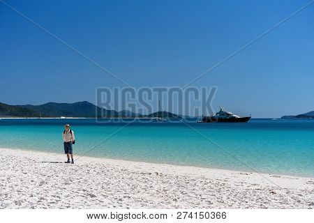 Whitsundays, Australia - August 24th: Male Tourist With Backpack Enjoying The Scenery And White Sili
