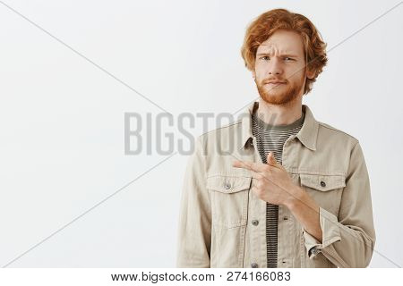 Waist-up Shot Of Doubtful And Dissatisfied Unsure Redhead Bearded Husband In Outdoor Beige Jacket Fr