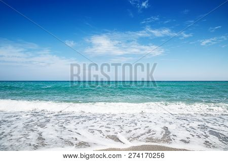 Abstract Blue Sea Water With White Foam For Background