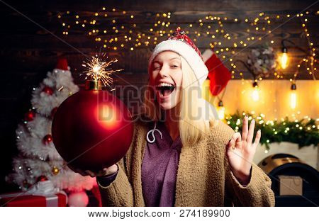 Christmas Woman Hold Bomb. Woman Smile Christmas. Merry Christmas And Happy New Year. Crazy Comical
