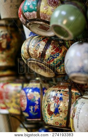 Multicoloured Blue, Gold, Red And Green Pots, Teapots And Little Containers In An Asian Market Hangi
