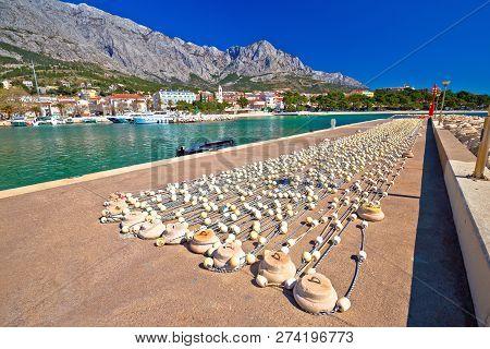 Baska Voda Waterfront Breakwater And Fishing Nets View, Makarska Riviera In Dalmatia, Croatia