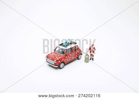 A Fun Of Santa Claus With Car