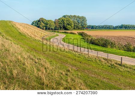 Meandering Country Road  Near The Dutch Village Of Lage Zwaluwe And Along The Dike After The Holland
