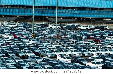 New Car Parked In A Row At Parking Lot Of Factory. Car Dealer Inventory Stock. Automotive Industry.
