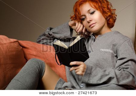 Red woman reading
