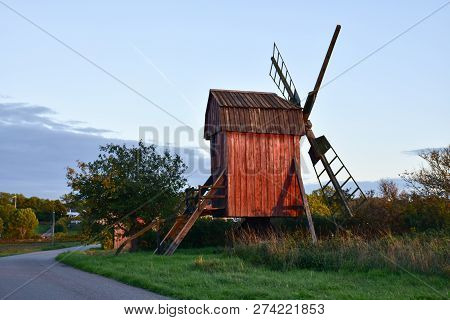 Sunlit Old Red Wooden Windmill At The Swedish Island Oland