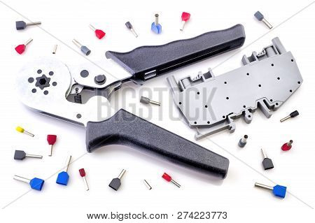 Crimping tool and electrical connectors isolated on white background closeup poster