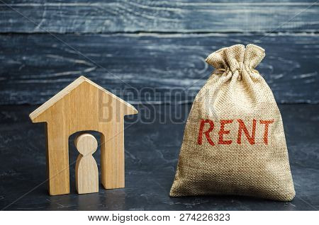 A Bag With Money And The Word Rent And A House With A Tenant Inside. The Accumulation Of Money To Pa