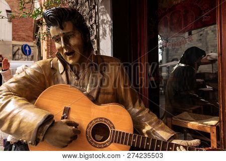 Genoa, Italy - April 17, 2014: A Statue Representing Elvis Presley Singing And Playing Guitar Outsid