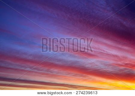 Beautiful Sunset Or Sunrise Background.  Extravaganza Of Colors In The Sky With Clouds