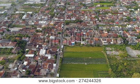 Aerial View Yogyakarta With Buildings And Houses At Sunset. Cityscape Densely Built Asian City Urban