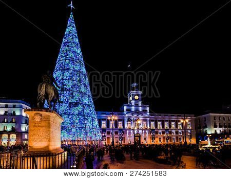 Madrid, Spain, December 2018. Puerta Del Sol Square At Nightfall Illuminated By Christmas Lights And