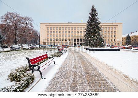 Uzhgorod, Ukraine - Jan 05, 2016: Christmas Tree On Narodna Square In Snow. Regional Government Admi