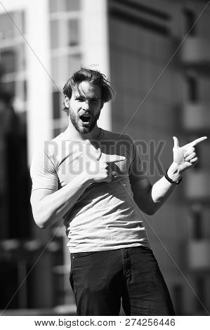 Casual Concept. Excited Man In Casual Wear Pointing Fingers In Street. Casual In Style. Casual Fashi