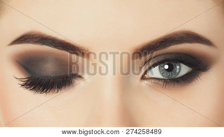 Beautiful Woman With Long Eyelashes And With Beautiful Evening Make-up. Eyes Close Up.one Eye Is Clo