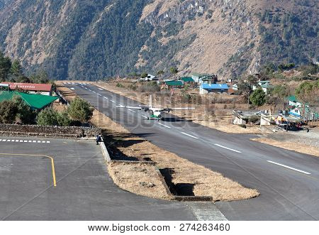 LUKLA, NEPAL - JANUARY 19, 2017: Aircraft Landing on Tenzing - Hillary Airport Runway