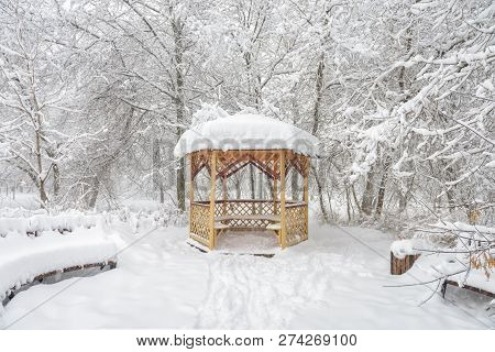 Snowy Summerhouse In Winter, Moscow, Russia. Empty Urban Park During Snowfall. Scenic View Of The Lo