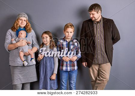 Mother, Father And Three Kids. Mother With Infant Baby, Two Senior Kids And Father, Family Portrait.