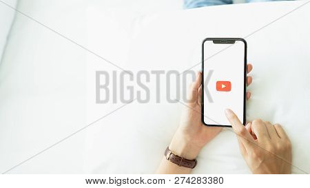Bangkok, Thailand - December 17, 2018 : Hand Is Pressing The Screen Displays The Youtube App Icons O