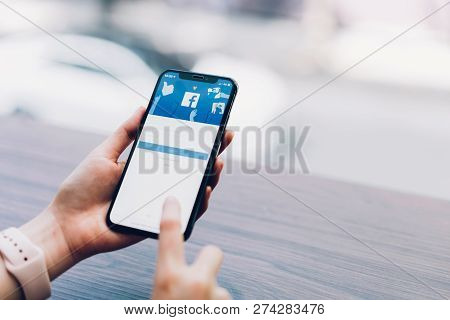 Bangkok, Thailand - December 17, 2018 : Hand Is Pressing The Facebook Screen On Apple Iphone X ,soci